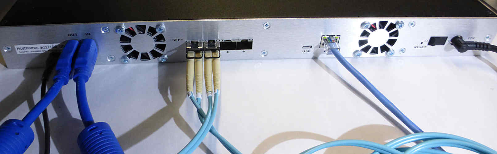 ACQ2106 rear panel showing 4 x SFP fiber-optic ports, SYNC cable and Ethernet.